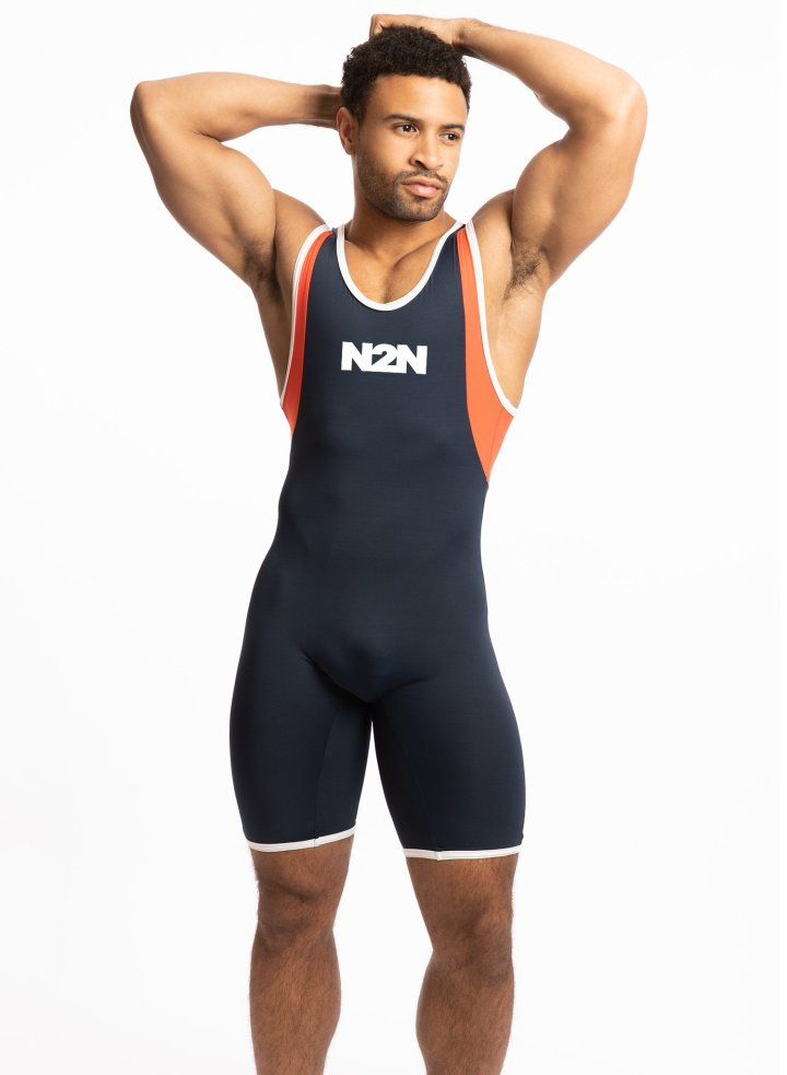 Model poses in a blue N2N wrestling singlet, with orange and white around the arm openings.