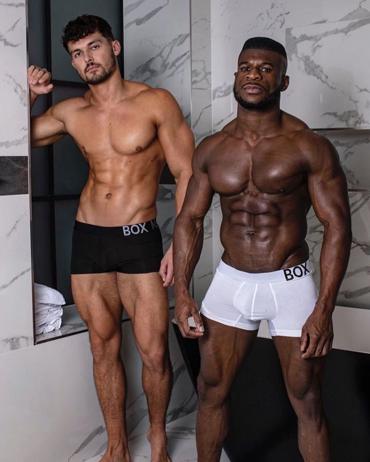 Fitness models Josh Watson and Daniel Shoneye pose in a locker room in Box Menswear king fit boxers.
