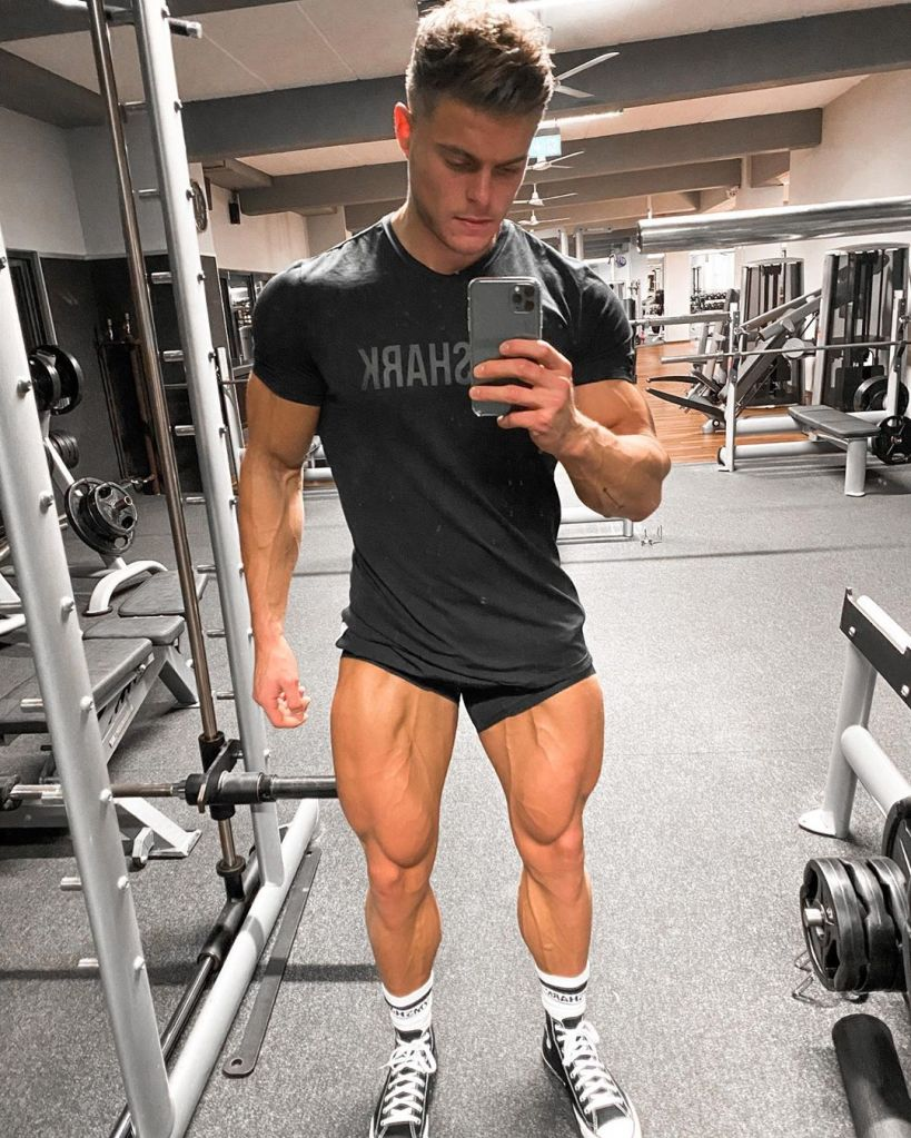Rchard Duchon, a law student  and fitness influencer from the Netherlands, takes a selfie with his Apple iPhone at a gym's Smith Machine.