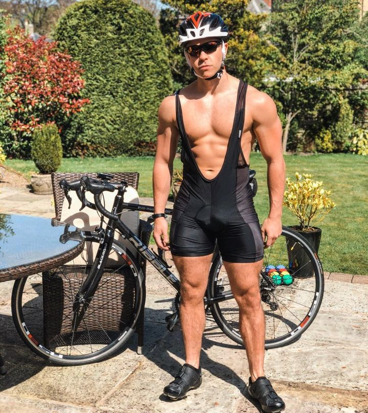 UK business owner and CrossFit enthusiast, Tom Seed, stands, in a lycra cycling garment in front of his Ribble Cycle bike.