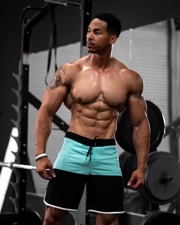Mens Physique Board Shorts: An Inspired, Dedicated Gym Trainer Prepares for Competition